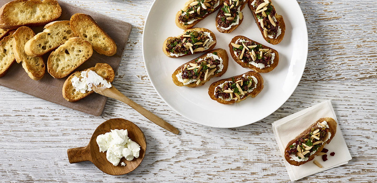 Warm Chevre Crostini with Cranberry Basil Tapenade
